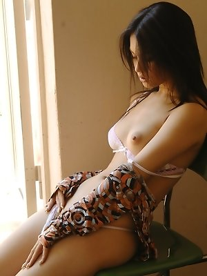 Lovely Asian babe shows off...